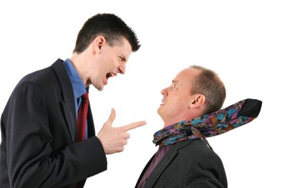 young man arguing with dad - dealing with issues of a young adult after graduation